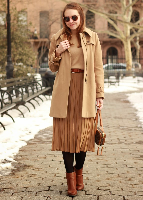 The Steele Maiden: Camel wool coat, cashmere sweater and pleated midi skirt