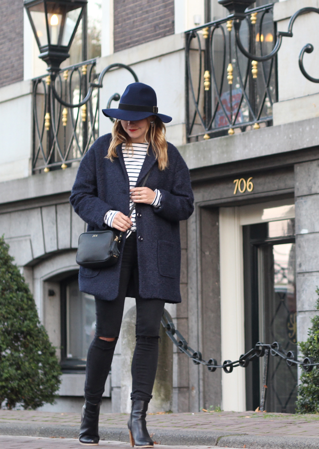 Amsterdam wearing Paige denim and wool floppy hat