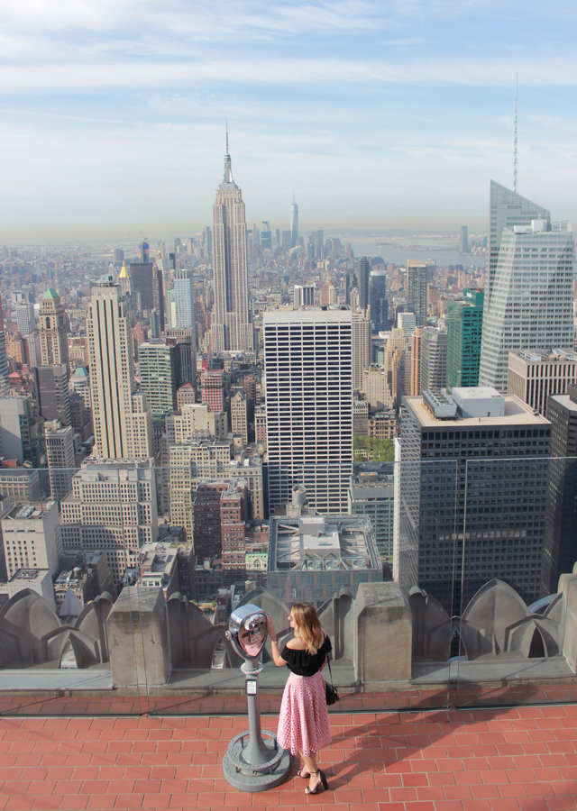 Top of the Rock NYC in pink midi skirt and off the shoulder top