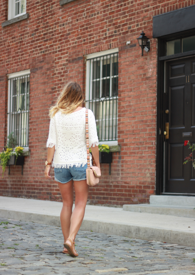 Fringed summer sweater and denim shorts