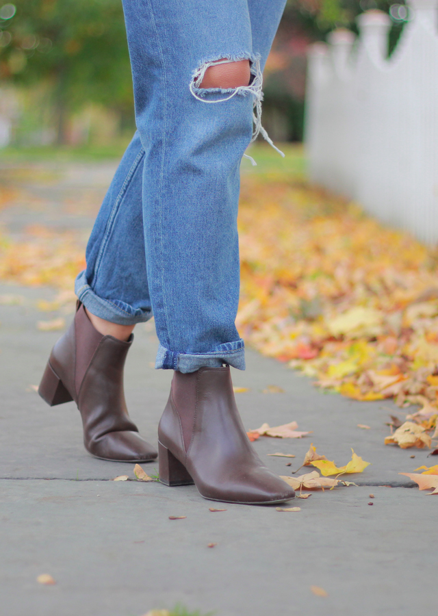 The Steele Maiden: Fall foliage wearing cable knit turtleneck, boyfriend jeans and ankle boots