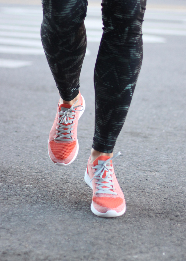 Running activewear leggings and sneakers